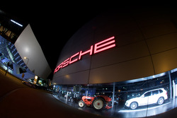 The Porsche Museum and the Porsche dealership on Porscheplatz by night