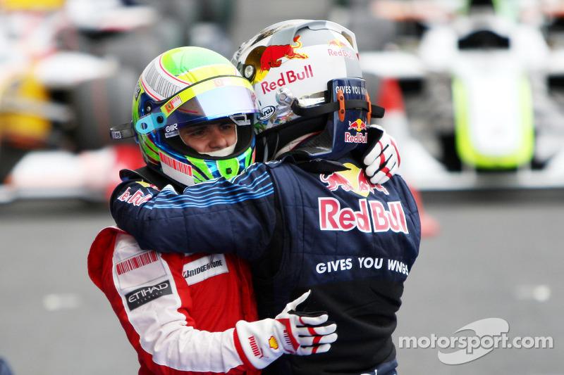 Race winner Mark Webber, Red Bull Racing celebrates with Felipe Massa, Scuderia Ferrari