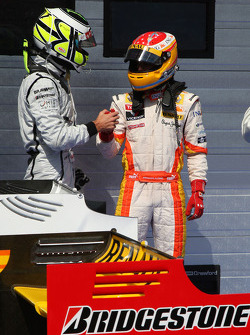 Pole winner Fernando Alonso, Renault F1 Team tries to figure the final qualifying order with Jenson Button, Brawn GP