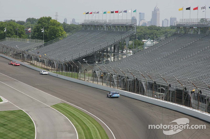 Downtown Indianapolis is seen through the grandstands in the south short-chute