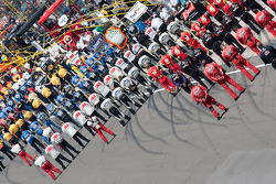 The NASCAR Sprint Cup teams line up for the National Anthem