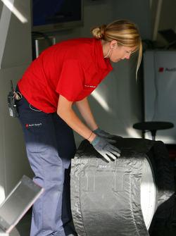 Female mechanic working on the car of Katherine Legge, Audi Sport Team Abt Audi A4 DTM