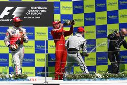 Podium: champagne celebration for race winner Rubens Barrichello, BrawnGP, second place Lewis Hamilton, McLaren Mercedes, third place Kimi Raikkonen, Scuderia Ferrari