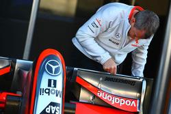 McLaren Mercedes Team member working on a front wing