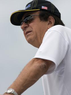 John Menard watches the pre-race activity from atop his hauler