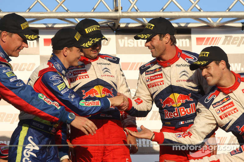 Podium: provisional second and final winners Mikko Hirvonen and Jarmo Lehtinen, with provisional winners and final second Sébastien Loeb and Daniel Elena