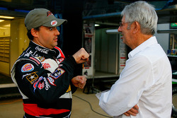 Tony Stewart, driver of the #14 Bass Pro Shops Chevrolet speaks with NASCAR legend Leonard Wood