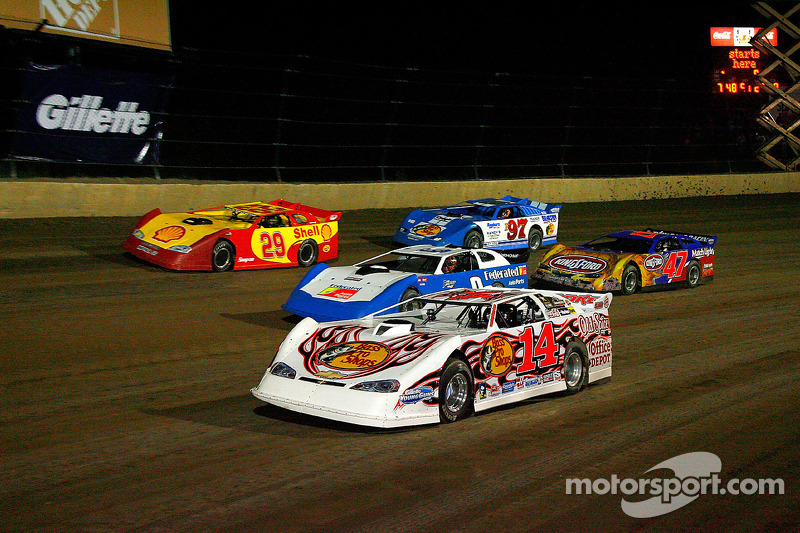 Tony Stewart, driver of the #14 leads a pack of cars