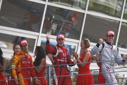 Luiz Razia celebrates his victory on the podium with Nico Hulkenberg and Lucas Di Grassi