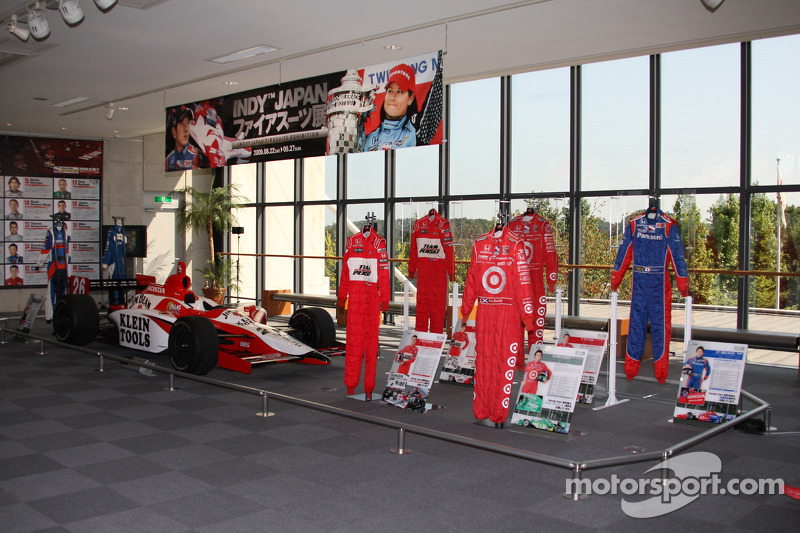 Honda Collection Hall: display of IndyCar Series drivers firesuits and 2005 winning car of Dan Wheldon