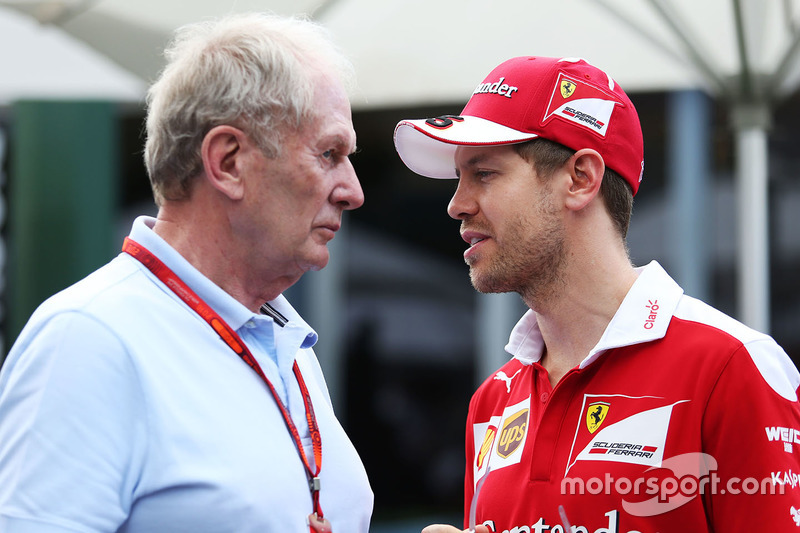 Sebastian Vettel, Ferrari con el Dr Helmut Marko, Red Bull Motorsport Consultor