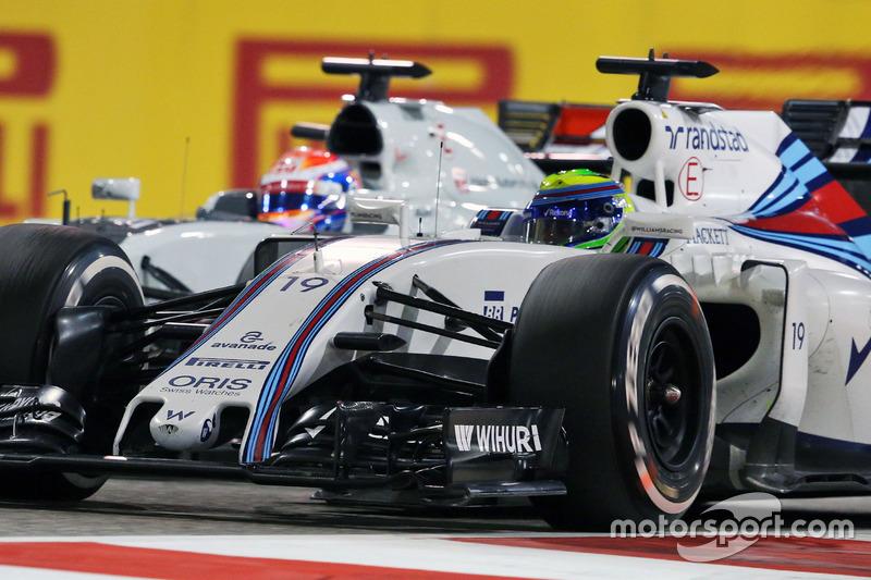 Felipe Massa, Williams FW38 et Romain Grosjean, Haas F1 Team VF-16 en lutte pour une position