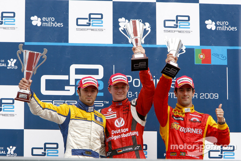 Nico Hulkenberg celebrates his victory on the podium with Luca Filippi and Lucas Di Grassi