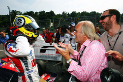 Race winner Andy Soucek celebrates with his Father Dieter in Parc Ferme