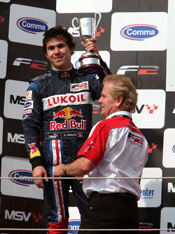 Second placed Robert Wickens celebrates on the podium with Jonathan Palmer Motorsport Vision Chief Executive