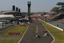 Robert Kubica, BMW Sauber F1 Team and Jenson Button, Brawn GP