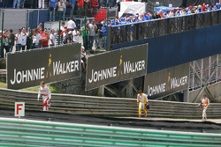 Jarno Trulli, Toyota F1 Team,walks back after crashing with Fernando Alonso, Renault F1 Team and Adrian Sutil, Force India F1 Team