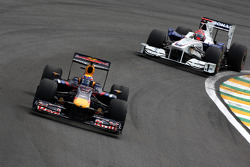 Mark Webber, Red Bull Racing leads Robert Kubica, BMW Sauber F1 Team