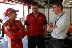 Sebastian Hohenthal talks with an F2 mechanic