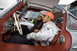 Lewis Hamilton sits in a gullwing