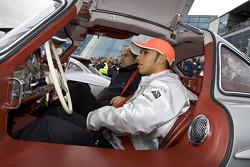 Lewis Hamilton sits a gullwing
