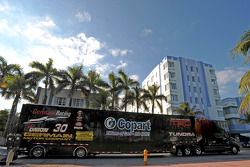 The No. 30 NASCAR Camping World Truck Series hauler rolls into Lummus Park on South Beach in Miami during a hauler parade through the city