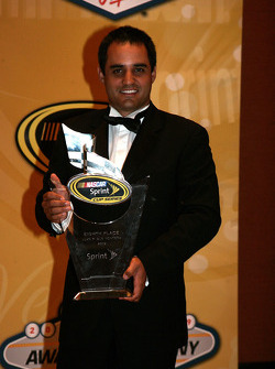 Juan Pablo Montoya with his award for eighth place in the Chase for the NASCAR Sprint Cup
