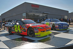 Hendrick Motorsports race shop with show cars in front of one building
