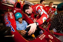 Alexander Rossi meets local children visiting the GP2 paddock