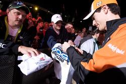 Joey Logano, Joe Gibbs Racing Toyota signs autographs