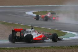 Jenson Button, McLaren Mercedes, MP4-25 follows Fernando Alonso, Scuderia Ferrari