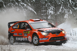 Henning Solberg en Ilka Minor, Ford Focus RS WRC 08, Stobart VK M-Sport Ford Rally Team