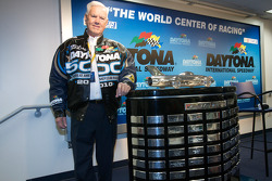 Junior Johnson poses with the Harley F. Earl Daytona 500 Trophy