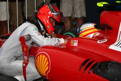 Michael Schumacher, Mercedes GP and Fernando Alonso, Scuderia Ferrari