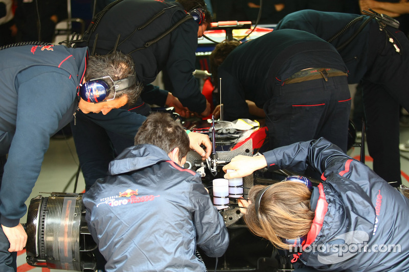 Toro Rosso mechanics working on the brakes