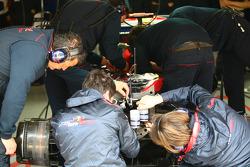 Toro Rosso mechanics working on the brakes