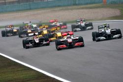 Jenson Button, McLaren Mercedes leads Nico Rosberg, Mercedes GP