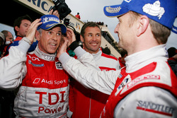 Race winners Rinaldo Capello and Allan McNish celebrate with Tom Kristensen