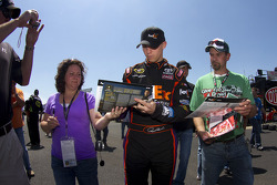 Denny Hamlin, Joe Gibbs Racing Toyota signs autographs
