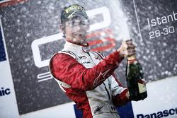 Esteban Gutierrez celebrates victory on the podium