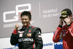 Rio Haryanto celebrates victory on the podium with Alexander Rossi