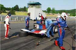 Dejected crew walk away from the Porsche Riley