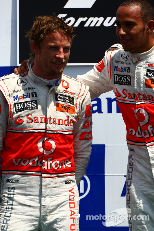 Podium: race winnaar Lewis Hamilton, McLaren Mercedes en 2de Jenson Button, McLaren Mercedes