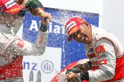Podium: race winner Lewis Hamilton, McLaren Mercedes and second place Jenson Button, McLaren Mercedes