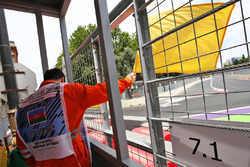 A marshal waves the yellow flag