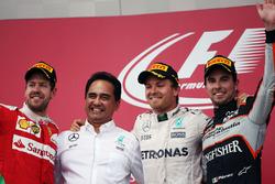 Il podio (da Sx a Dx): Sebastian Vettel, Ferrari, secondo; Nico Rosberg, Mercedes AMG F1, vincitore della gara; Sergio Perez, Sahara Force India F1, terzo
