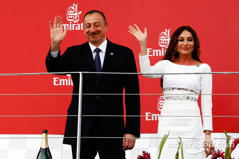 (L to R): Ilham Aliyev, Azerbaijan President with his wife Mehriban Aliyeva, on the podium