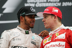 (L to R): Race winner with Lewis Hamilton, Mercedes AMG F1 on the podium