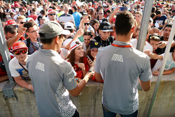 Rio Haryanto, Manor Racing and team mate Pascal Wehrlein, Manor Racing sign autographs for the fans