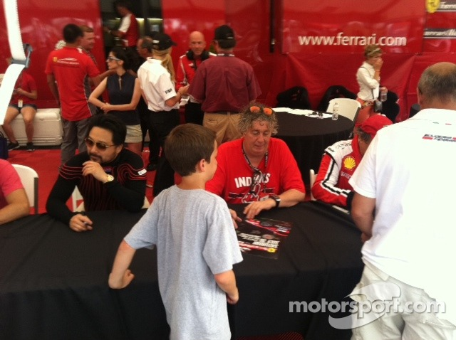Jim Weiland signing autographs for a young fan
